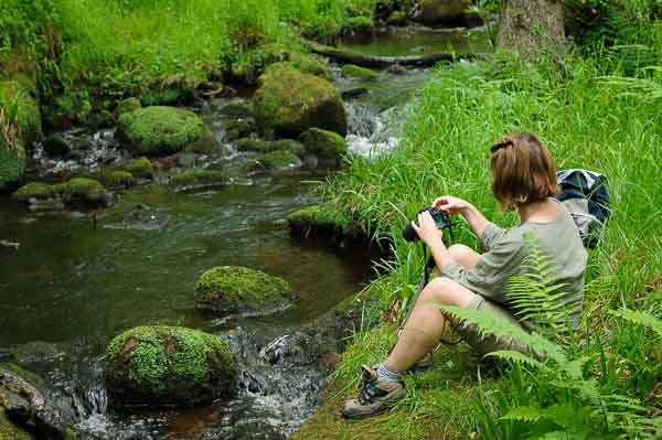 Photographing moving water on a photography course in the Derbyshire Peak District. Photo © Chris James