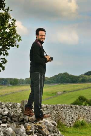 A photographer standing on a drystone wall on a digital camera course in the Derbyshire Peak District