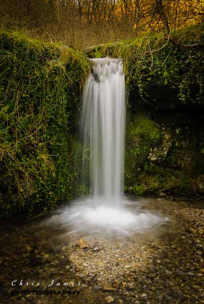 A waterfall in Lathkill Dale © Chris James