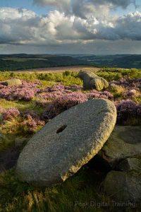 Millstone on moorland near Sheffield. Photo © Chris James