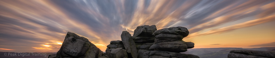 Sunset over rocks on the edge of Sheffield. Photo © Chris James