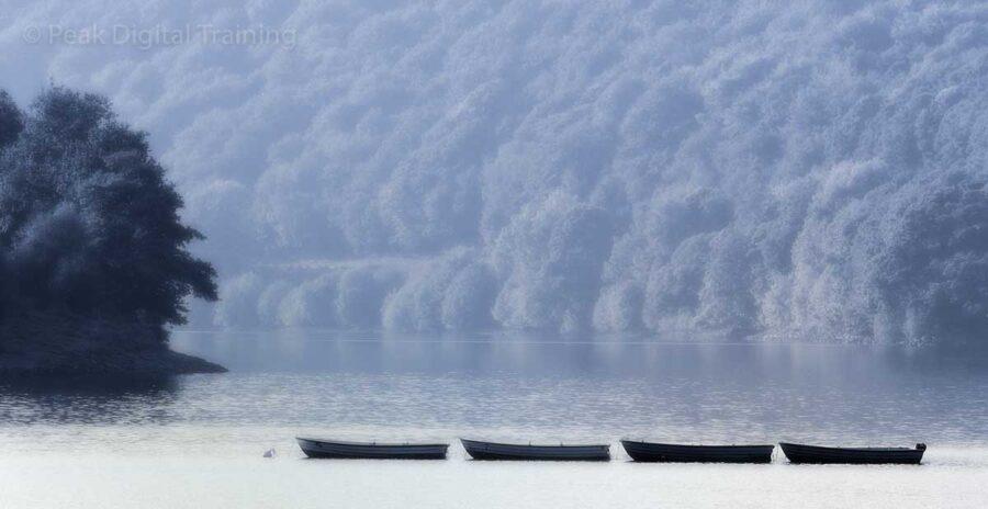 Boats on Ladybower Reservoir, edited using Photoshop. Photo © Chris James