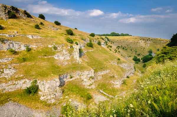 Limestone cliffs in Lathkill Dale in the Derbyshire Peak District