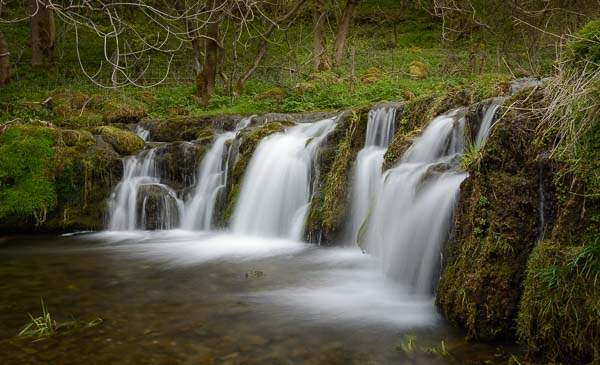Waterfall in Lathkill Dale, in the Derbyshire Peak District. Photo © Chris James