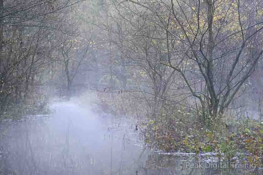 Mist over the R. Lathkill in the Peak District. Photo © Chris James
