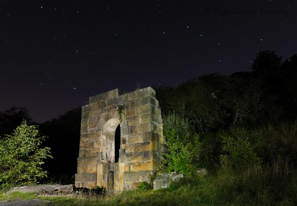 Derelict mine building at night in the Peak District. Photo © Chris James